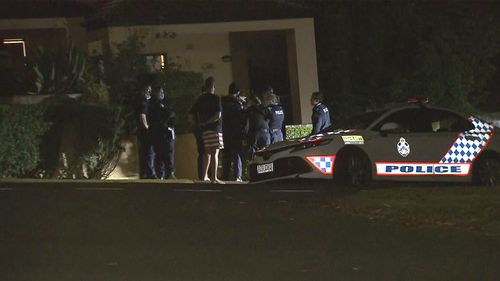 Queensland Police stand outside Toutai Kefu's Brisbane home, where he and his family were attacked.