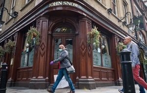 UK scraps quarantine for some visitors as pubs set to reopen