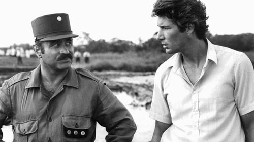 Bob Hoskins suspects Richard Gere of subversive activity in a scene from the film 'Beyond The Limit', 1983. (Getty)