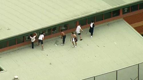 Teens smashing windows in 2016.
