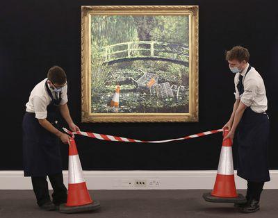 Banksy artwork sells for $14m