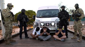 Police watch over suspects after 1.2 tonnes of meth was seized after it was offloaded from a boat in Western Australia, in 2017.