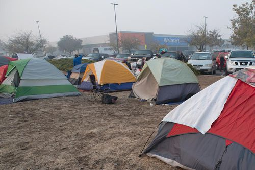 Some evacuees remain at an informal shelter outside a Walmart store in Chico.