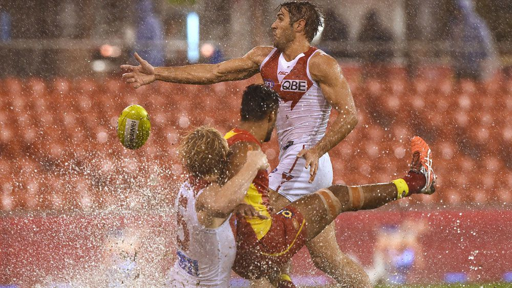 Swans down Suns on soggy Gold Coast