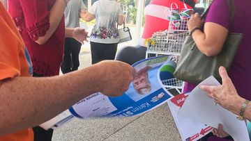An image that purportedly shows One Nation volunteer handing out LNP how-to-vote cards at a pre-polling station in the Brisbane suburb of Lytton on Monday. (AAP)