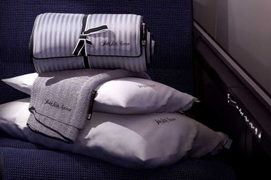Business class passengers are treated to plush Saks Fifth Avenue bedding.