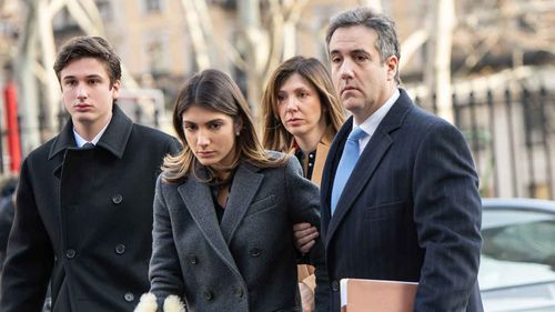 Michael Cohen outside court with his family.