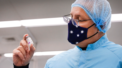 Prime Minister Scott Morrison hold a vial of AsteZeneca produced by the CSL lab in Parkville Melbourne. Picture: David Caird
