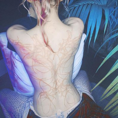 Grimes debuted an intricate back tattoo.