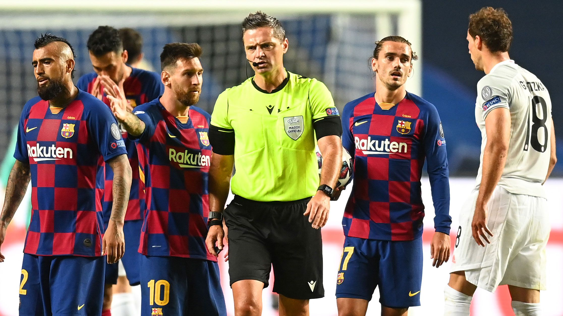 Lionel Messi of FC Barcelona confronts referee Damir Skomina during the UEFA Champions League Quarter Final match between Barcelona and Bayern Munich.