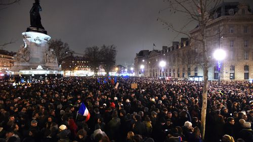 People gather at the Place de la Republique (Republic square) in Paris in honour of those killed in the Charlie Hebdo attack. (Getty)
