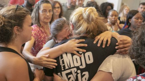 Students who were bussed to First Baptist Church are reunited with family members. (AP)