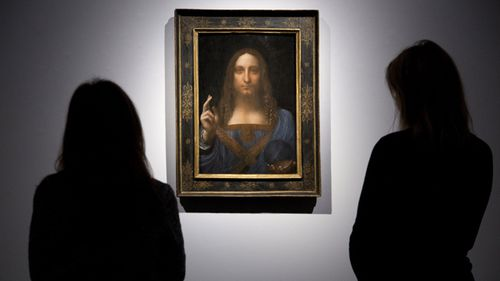 People look at Leonardo da Vinci's Salvator Mundi at Christie's in London, before the work was sold in New York.