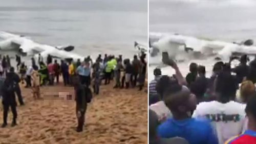 Crowd gathers at the shoreline after a cargo plane crashed into the Atlantic Ocean shortly after taking off from Ivory Coast's international airport in Abidjan, Ivory Coast. (AP)