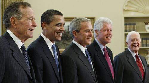 President George W. Bush, centre, with President-elect Barack Obama, second left, and former presidents, George H.W. Bush, left, Bill Clinton, second right, and Jimmy Carter, right, in the Oval Office in 2009.