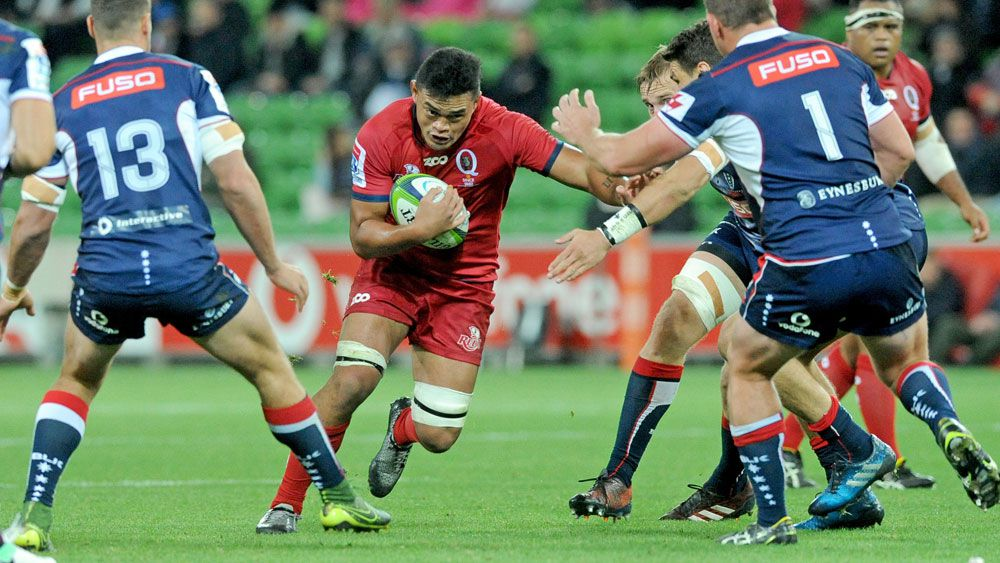 Reds player Hendrik Tui takes on the Rebels defence. (AAP)