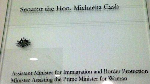 Senator Michaelia Cash's glass door at Parliament House.