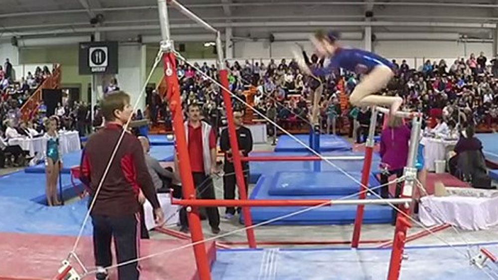 Coach makes acrobatic catch to save gymnast