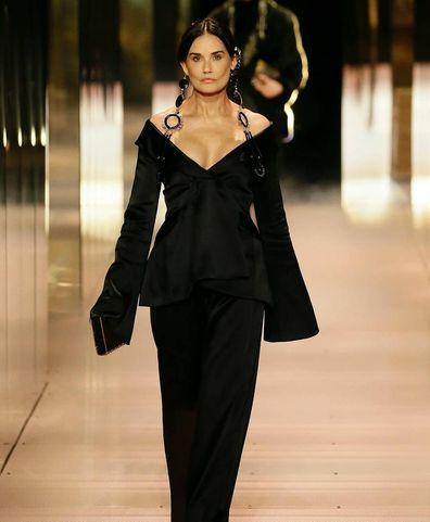 Demi Moore walks the Paris Fashion runway show.