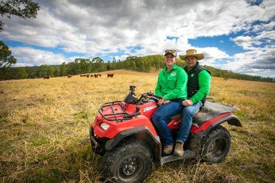 Bianca and Dave farm on vehicle on farm