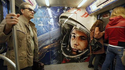 A train on the Moscow Metro is painted to pay tribute to Yuri Gagarin.