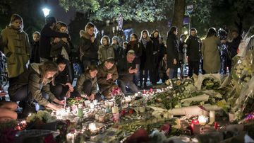 People gather outside the Bataclan in Paris after the attacks. (AAP)