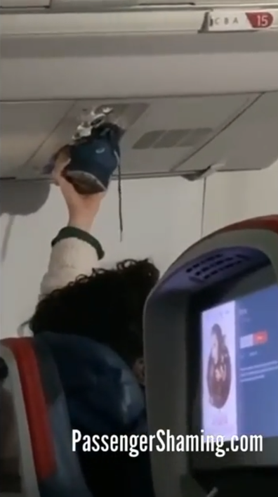 Man hold wet shoe up to plane fan nozzle