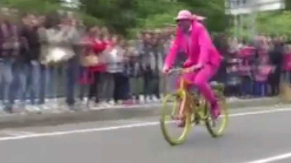 A pink-suited cyclist strayed onto the Giro d'Italia course.