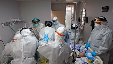 Dr. Joseph Varon, right, leads a team as they try to save the life of a patient unsuccessfully inside the Coronavirus Unit at United Memorial Medical Center, Monday, July 6, 2020, in Houston.