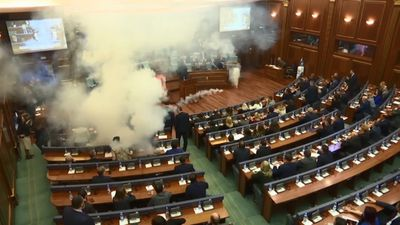 Wild scenes in Kosovo as tear gas flung around parliament