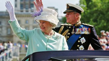 "The Queen and the Duke of Edinburgh, Prince Philip, wave to the crowd as they leave  the ""Recollections Of World War II Commemoration Show"" in 2005"