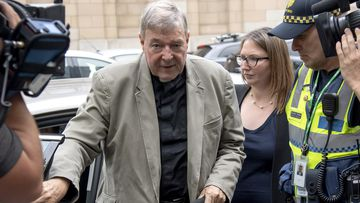 Cardinal George Pell leaves the County Court in Melbourne, Australia, Tuesday, Feb. 26, 2019.