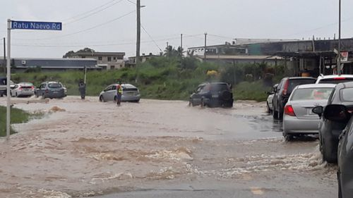 Roads and cars remain underwater as heavy rainfall continues to lash Fiji as the category 1 cyclone passes. Picture: Halitesh Datt.