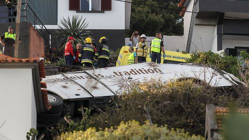 Emergency services inspect the scene of a tourist bus crash in Canico, Santa Cruz, Madeira Island.