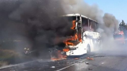 The Australian and New Zealand bus passengers were moved off the bus before flames engulfed the vehicle. (9NEWS)