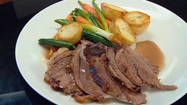 Roasted leg of spring lamb with a panache of vegetables
