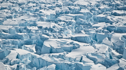 This 2010 photo provided by researcher Ian Joughin shows crevasses near the edge of Pine Island Glacier, Antarctica. In a study released Wednesday, June 13, 2018, an international team of ice experts said the melting of Antarctica is accelerating at an alarming rate, with about 3 trillion tons of ice disappearing since 1992. (Ian Joughin/University of Washington via AP)