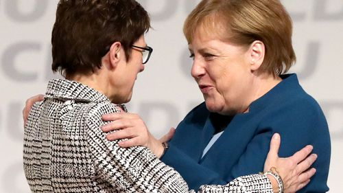 German Chancellor Angela Merkel embraces her newly-elected replacement as CDU leader, Annegret Kramp-Karrenbauer.
