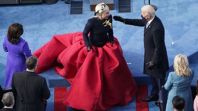 President-elect Joe Biden greets Lady Gaga during the 59th Presidential Inauguration at the U.S. Capitol in Washington, Wednesday, Jan. 20, 2021.