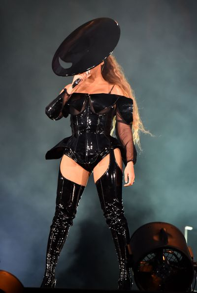 Black latex bodysuits, over-the-knee-boots, and oversized hats were a costume favourite during the 'On The Run' performance.