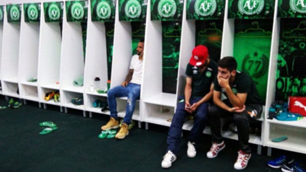 Devastated non-travelling Chapecoense players in the team's changing room.