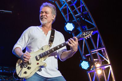 Van Halen, band, guitarist Eddie Van Halen, on stage, perform