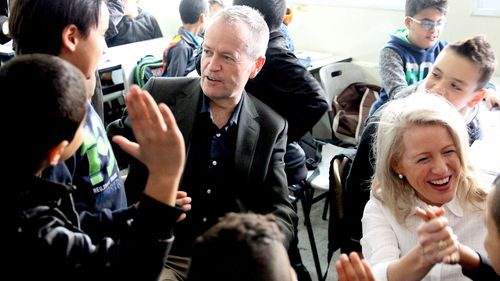 Labor leader Bill Shorten (left) and his wife Chloe visiting the UNRWA Aida Refugee Camp in Bethlehem in the occupied West Bank. (AAP)