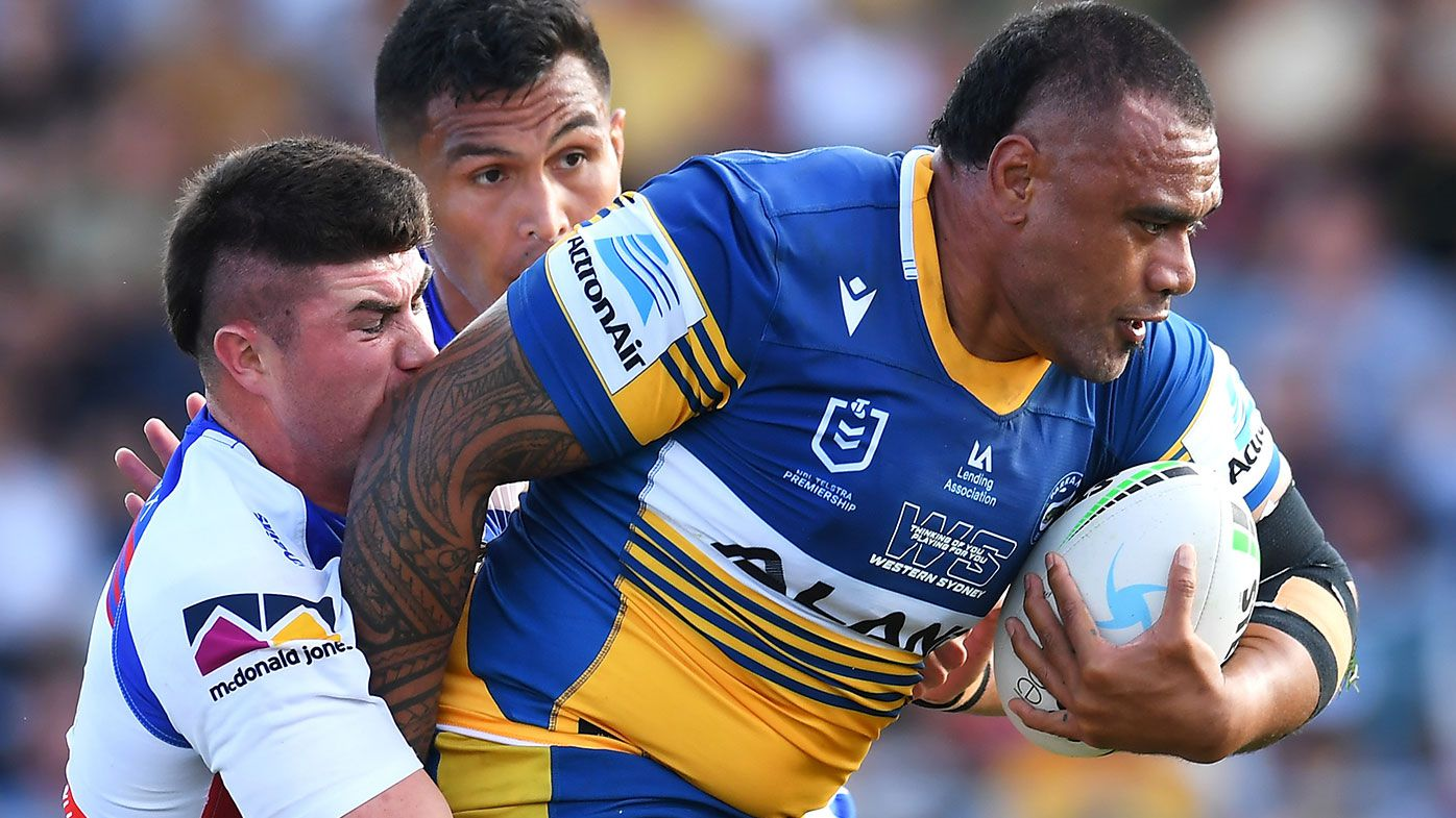 Junior Paulo of the Eels is tackled by Bradman Best of the Knights during the NRL Elimination Final match between Parramatta Eels and Newcastle Knights at Browne Park, on September 12, 2021, in Rockhampton, Australia. (Photo by Albert Perez/Getty Images)