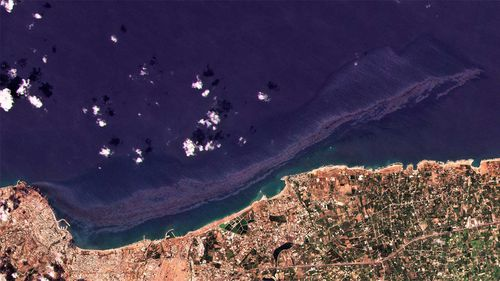 Cypriot authorities say an oil spill that originated from Syria's largest refinery is growing and spreading across the Mediterranean Sea.
