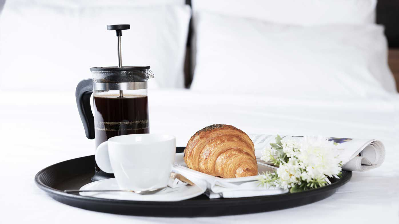 Room service breakfast with croissant and coffee