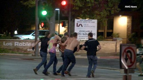 As the shots rang out from inside the California bar however, terrified customers were seen shattering windows in an attempt to escape.