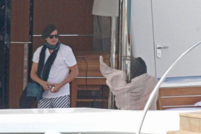 Ashton and Demi brave the wind on board the world's most expensive yacht (so he can smoke a ciggie) off the coast of the West Indies.