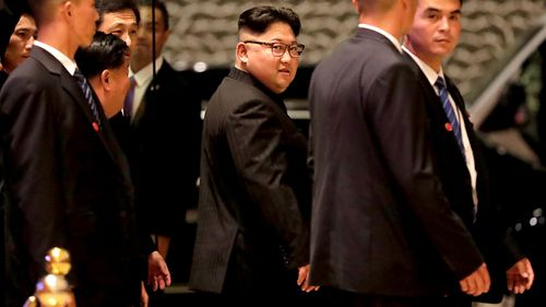 North Korean leader Kim Jong-un walks out from the Marina Bay Sands during a city tour in Singapore. (AAP)