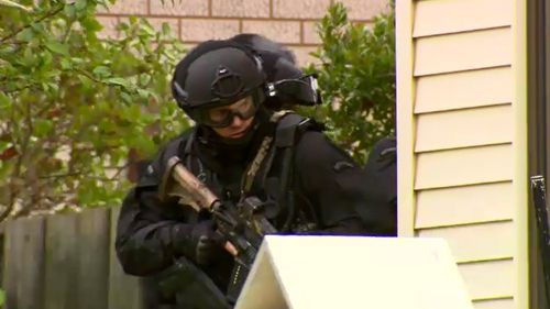 The man surrendered himself just after 1pm today. (9NEWS)